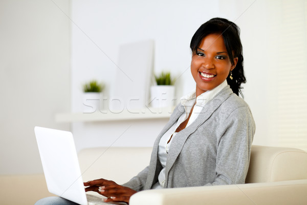 Stock photo: Happy woman browse the Internet on laptop