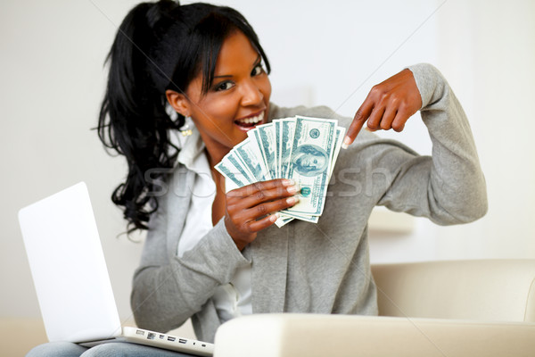 Happy young woman pointing plenty of cash money Stock photo © pablocalvog