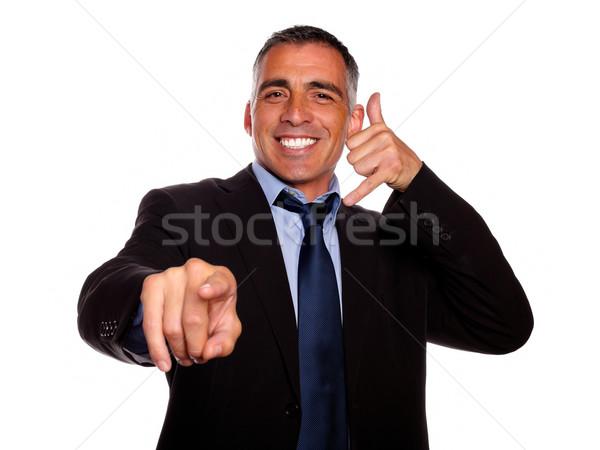 Ambitieus makelaar wijzend portret glimlachend zwart pak Stockfoto © pablocalvog