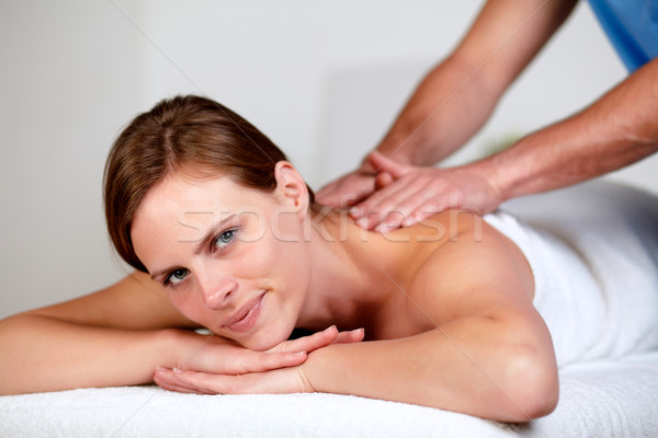 Stock photo: Pretty blonde woman relaxing at a spa
