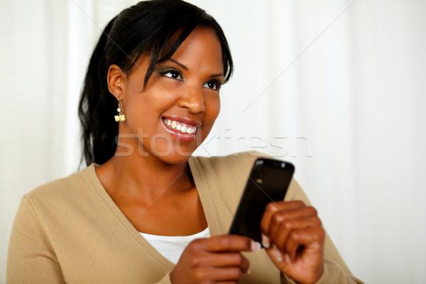 Сток-фото: улыбаясь · женщины · сообщение · портрет