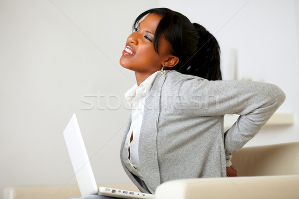 Afro-american young woman with back pain Stock photo © pablocalvog