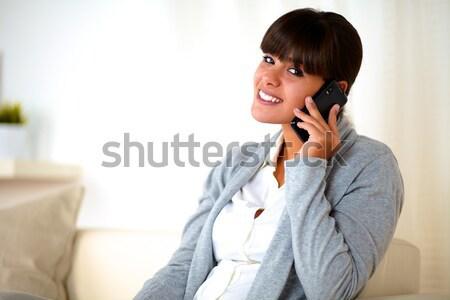 étonné jeune femme lecture portable écran portrait Photo stock © pablocalvog