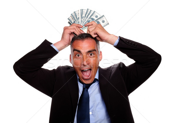 Victorious mature person with cash money Stock photo © pablocalvog