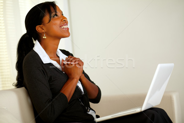 Beautiful business woman on black suit and smiling Stock photo © pablocalvog