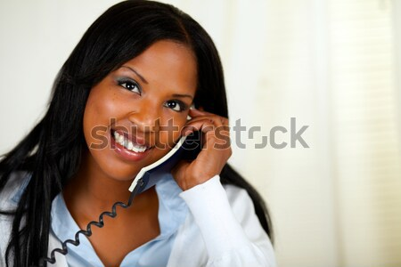 Stylish young woman conversing on cellphone Stock photo © pablocalvog