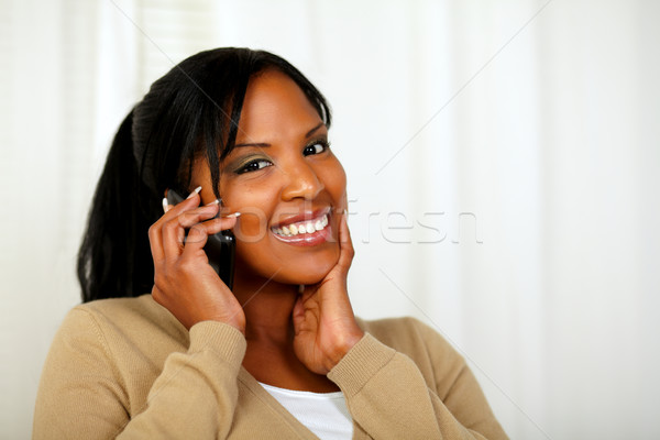 Stock photo: Fresh woman looking to you and talking on mobile