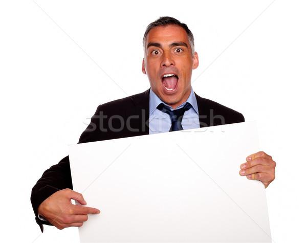 Bróker sikít mutat kártya portré tart Stock fotó © pablocalvog