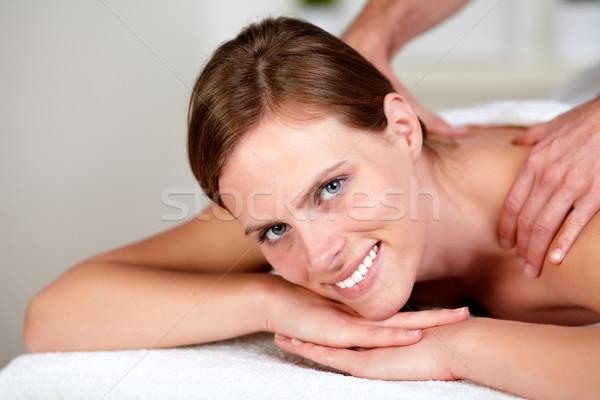 довольно девушки улыбаясь расслабляющая портрет массаж Сток-фото © pablocalvog