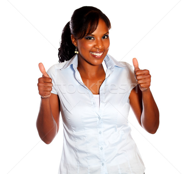 Positive young female lifting the fingers up Stock photo © pablocalvog