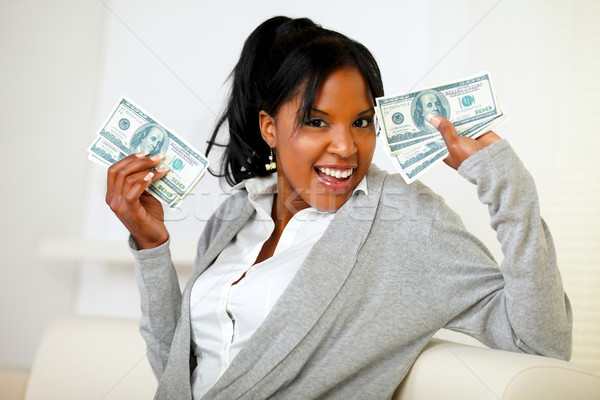Afro-american girl holding plenty of cash money Stock photo © pablocalvog