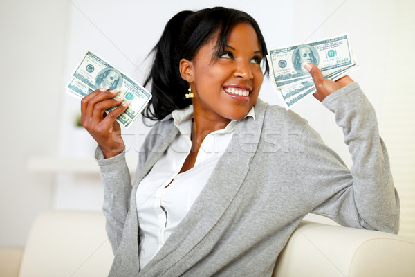 Beautiful girl holding plenty of cash money Stock photo © pablocalvog