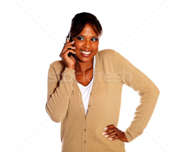 Pretty young woman speaking on cellphone Stock photo © pablocalvog