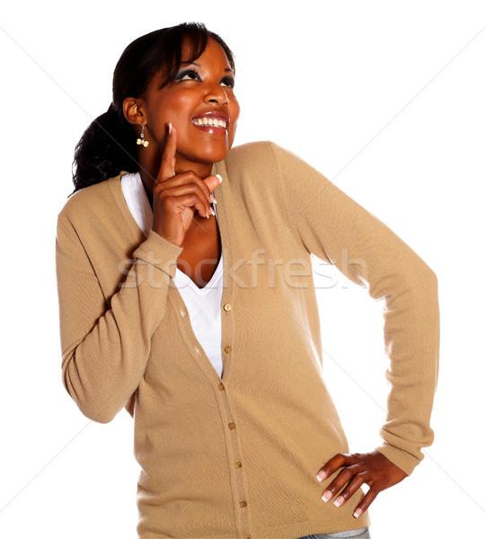 Atrakcyjny czarnej kobiety wskazując odizolowany tle Zdjęcia stock © pablocalvog