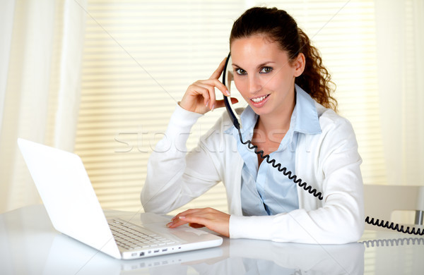 Charming woman looking at you speaking on phone Stock photo © pablocalvog