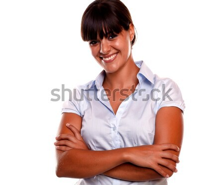 Attractive young woman looking and smiling at you Stock photo © pablocalvog