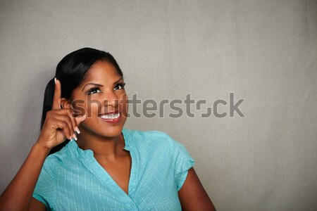 Surprised young woman looking at you Stock photo © pablocalvog
