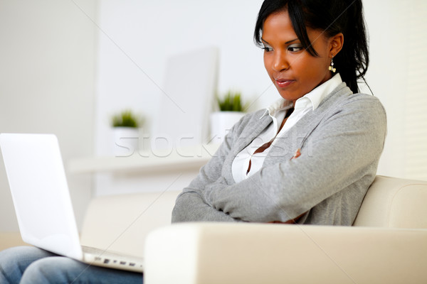 Reflective young woman reading on screen Stock photo © pablocalvog