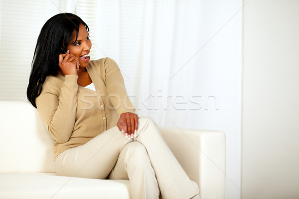Güzel kadın oturma kanepe konuşma cep telefonu portre Stok fotoğraf © pablocalvog