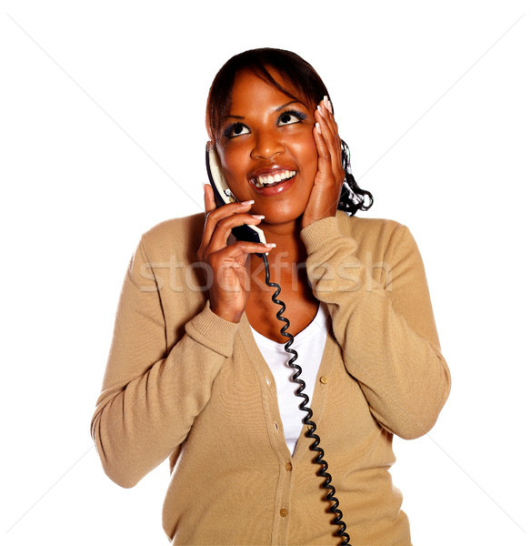 Excited female talking on phone and looking up Stock photo © pablocalvog