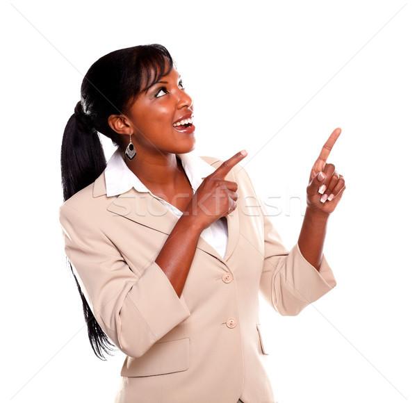 Stockfoto: Jonge · zakenvrouw · naar · wijzend · omhoog · geïsoleerd
