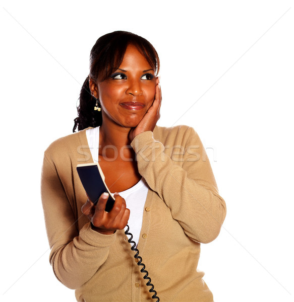 Smiling young female holding phone handset Stock photo © pablocalvog