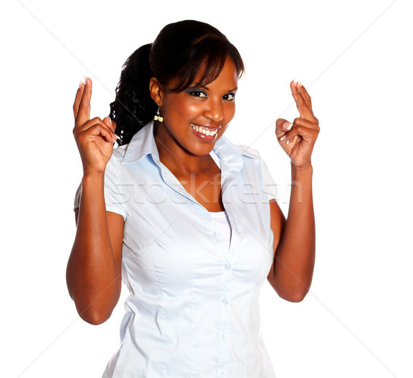 Pretty young woman crossing fingers Stock photo © pablocalvog