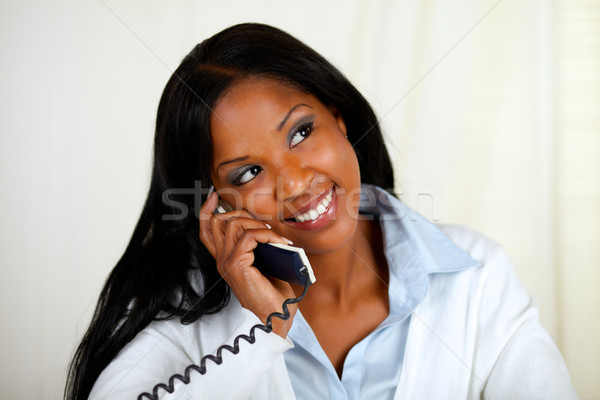 Young black woman conversing on phone Stock photo © pablocalvog