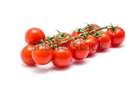 tomatoes with green leaves isolated on white background Stock photo © Pakhnyushchyy