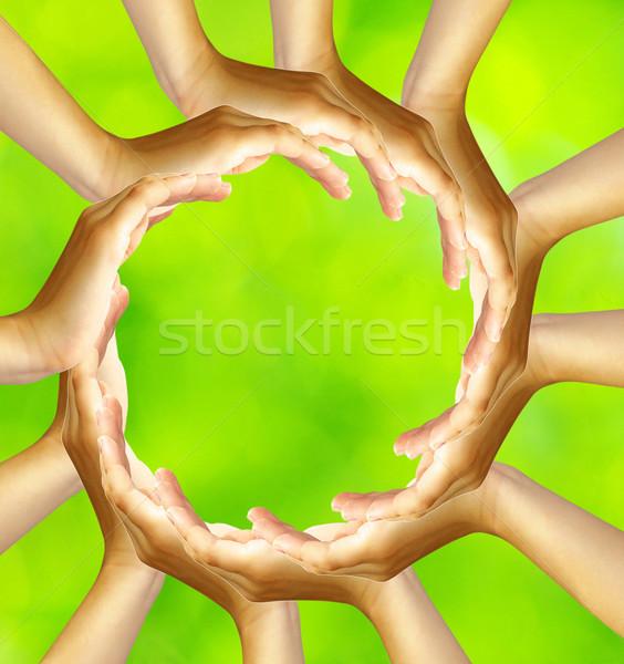 кольца рук изолированный зеленый сеть группа Сток-фото © Pakhnyushchyy
