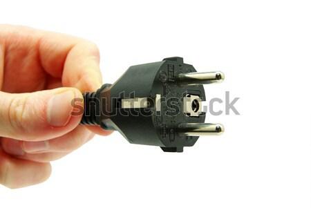 hand with plug  Stock photo © Pakhnyushchyy