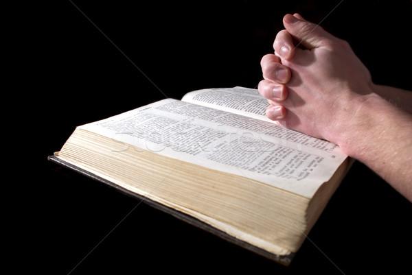 hands  on Bible Stock photo © Pakhnyushchyy