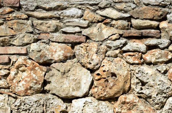 Pedras velho parede áspero fundo pedra Foto stock © Pakhnyushchyy