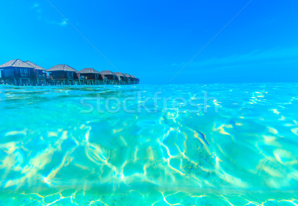 beach with water bungalows Maldives Stock photo © Pakhnyushchyy