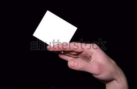 Boş kart el yalıtılmış siyah kâğıt çerçeve Stok fotoğraf © Pakhnyushchyy