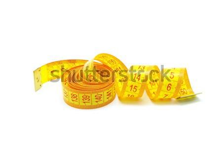 Mètre à ruban sur mesure blanche bande outil échelle Photo stock © Pakhnyushchyy
