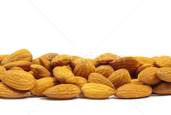 almonds on white Stock photo © Pakhnyushchyy