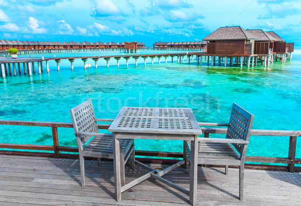 пляж тропический пляж пальмами синий пейзаж Сток-фото © Pakhnyushchyy
