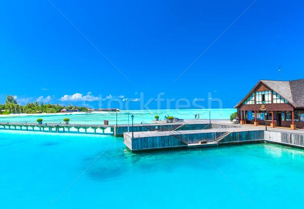 пляж воды дома пейзаж морем лет Сток-фото © Pakhnyushchyy