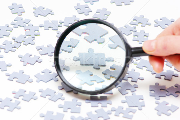 magnifying glass and puzzle  Stock photo © Pakhnyushchyy
