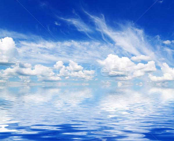 Branco fofo nuvens arco-íris blue sky céu Foto stock © Pakhnyushchyy