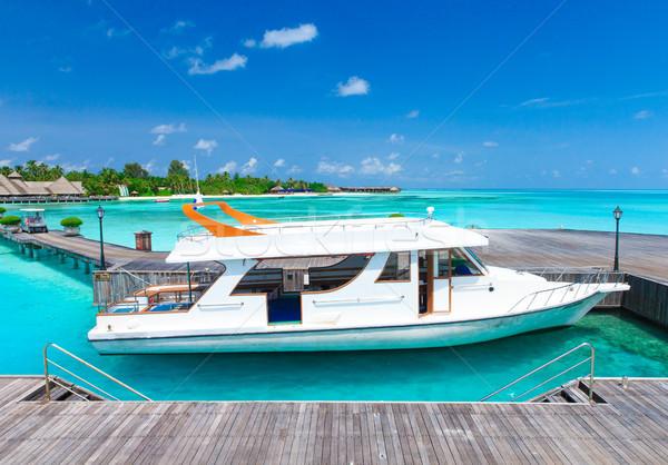 Playa playa tropical poco palmeras azul naturaleza Foto stock © Pakhnyushchyy
