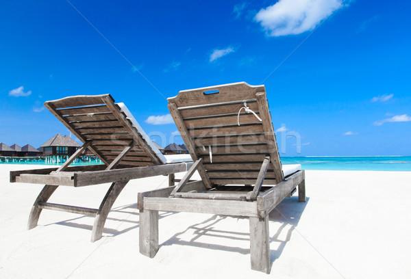 пляж тропический пляж пальмами синий небе Сток-фото © Pakhnyushchyy