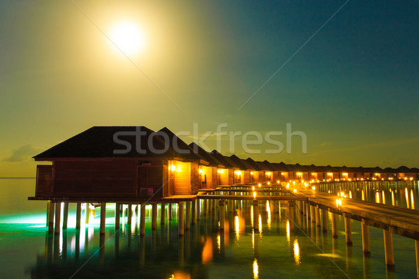 Gün batımı deniz gökyüzü gece gündoğumu ada Stok fotoğraf © Pakhnyushchyy