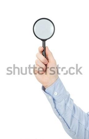 hand holding magnifying glass Stock photo © Pakhnyushchyy