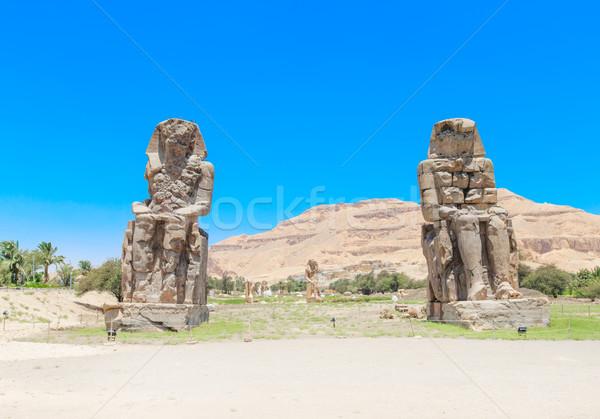 Egypt. Luxor. The Colossi of Memnon - two massive stone statues  Stock photo © Pakhnyushchyy
