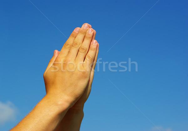 Mani preghiera gesto cielo luce potere Foto d'archivio © Pakhnyushchyy