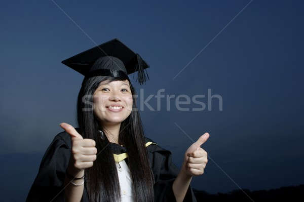 Smiling asian female graduate with good thumbs up sign Stock photo © palangsi