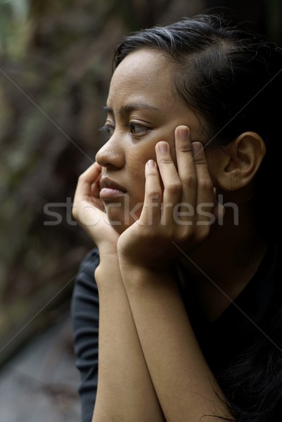 Troubled asian teen girl with hands holding face Stock photo © palangsi