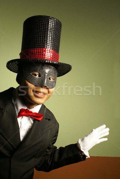 Smiling asian performer in mask and top hat Stock photo © palangsi
